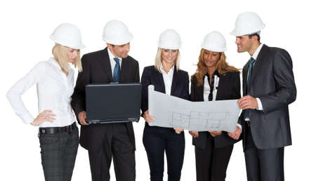 Architect group analyzing blueprints with laptop on white background photo