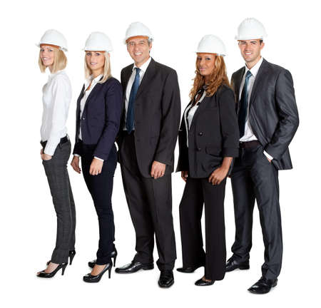construction companies: Portrait of team of confident civil engineer standing together isolated on white background