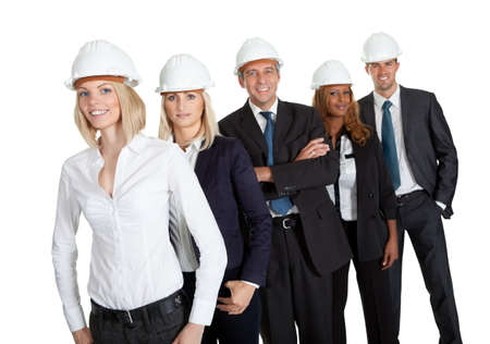 executive helmet: Pretty female civil engineer standing with her team on white background Stock Photo
