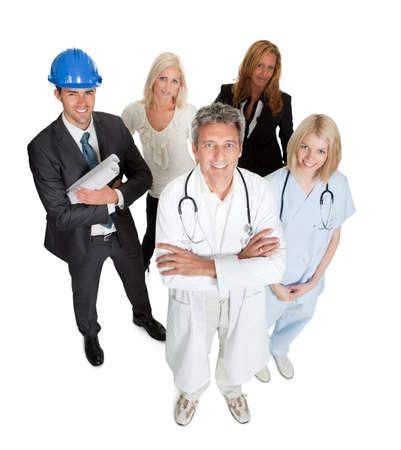 diferentes profesiones: Retrato de un grupo de profesionales aislados sobre fondo blanco Foto de archivo