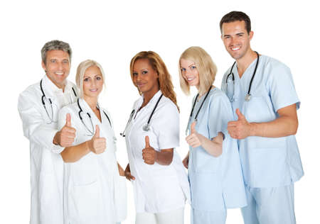 Group of doctors giving thumbs up sign isolated over white background photo