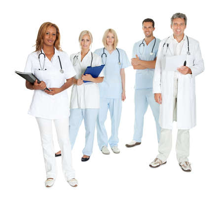 health professionals: Happy team of doctors and surgeons standing isolated on white background Stock Photo