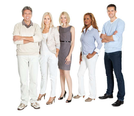 casual office: Portrait of business group standing confidently on white background