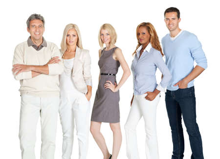 Portrait of an attractive young business group standing together on white background photo
