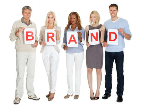 brand: Casual group of people with a brand sign board isolated on white background