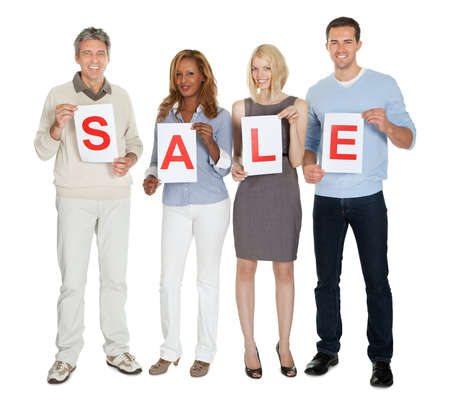 Portrait of happy businesspeople holding white paper with word sale on white background Stock Photo - 11582957
