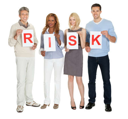 crisis management: Portrait of happy group of people holding sign board illustrating risk on white background