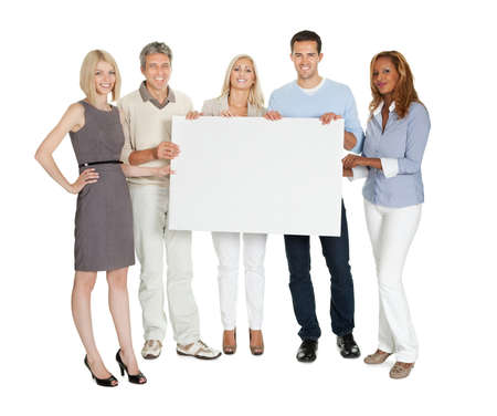 Casual group of people holding a blank billboard on white background