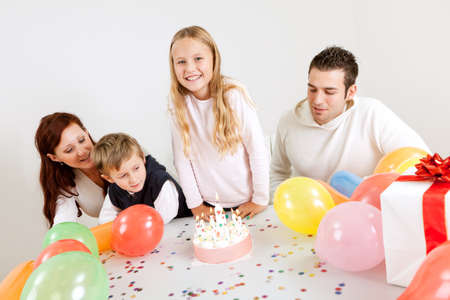 Young happy family celebrating birthday at home photo