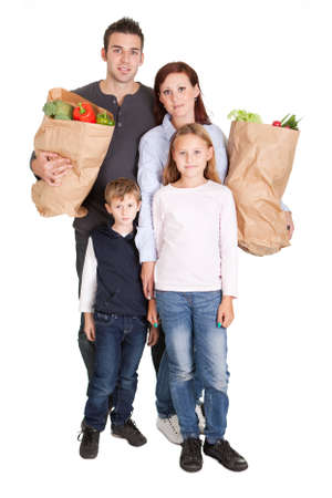Happy family with grocery shopping bags. Isolated on white photo
