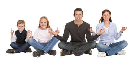man meditating: Cheeful young couple doing yoga exercise. Isolated on white