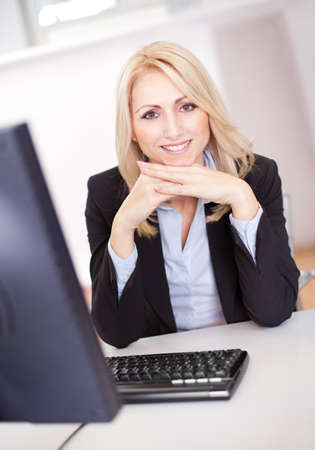 Beautiful businesswoman working on computer in the office Stock Photo - 12122619