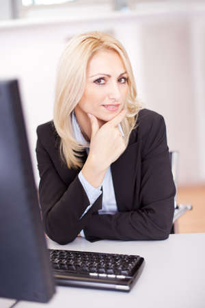 Beautiful businesswoman working on computer in the office Stock Photo - 12122582