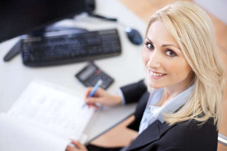 Beautiful businesswoman doing finances in the office Stock Photo