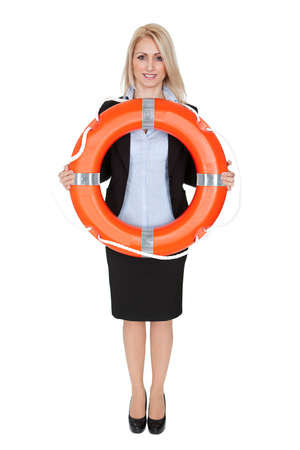 business survival: Beautiful businesswoman with life buoy. Isolated on white