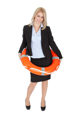 business life: Beautiful businesswoman with life buoy. Isolated on white