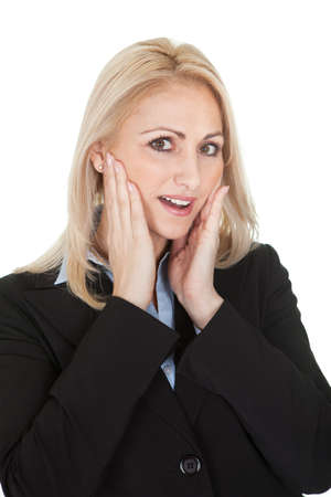 hand on mouth: Protrait of surprised businesswomen. Isolated on white