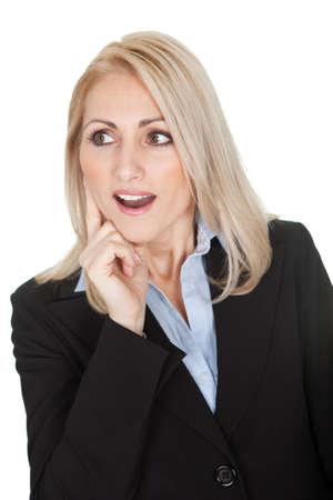 Protrait of surprised businesswomen. Isolated on white