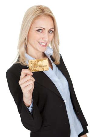 Businesswoman holding credit card. Isolated on white photo