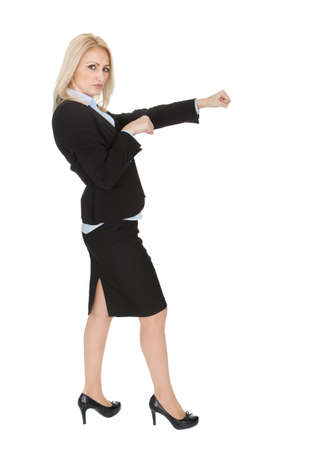 Beautiful businesswomen doing a punch. Isolated on white photo