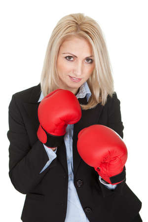 Beautiful businesswomen posing with boxing gloves. Isolated on white