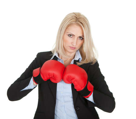 Beautiful businesswomen posing with boxing gloves. Isolated on white photo