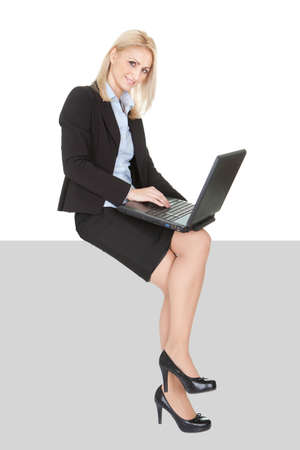Businnesswomen sitting on copyspace. Isolated on white