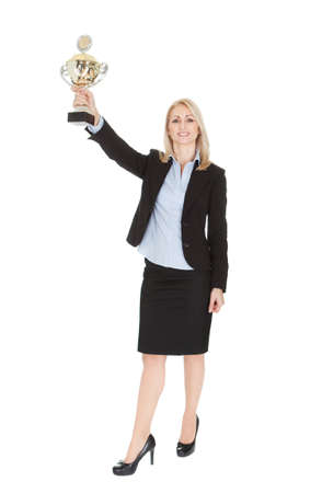 Businesswoman winning a trophy. Isolated on white Stock Photo - 12122889