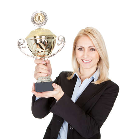 Businesswoman winning a trophy. Isolated on white photo