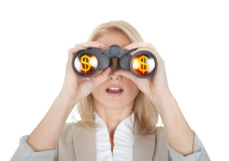 Businesswomen looking through binoculars. Isolated on white photo