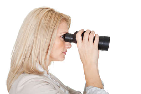 Businesswomen looking through binoculars. Isolated on white photo