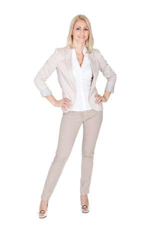 business woman standing: Portrait of beautiful sucessful businesswoman. Isolated on white Stock Photo
