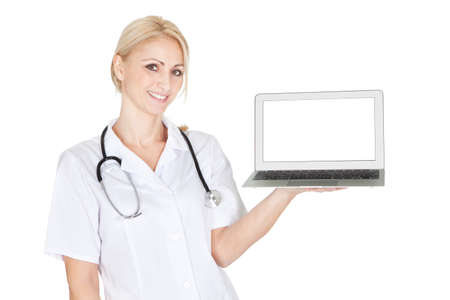 Smiling medical doctor woman presenting laptop. Isoalted on white photo