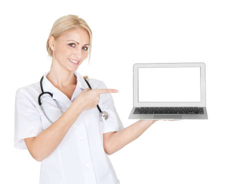 Smiling medical doctor woman presenting laptop. Isoalted on white Stock Photo - 12122800