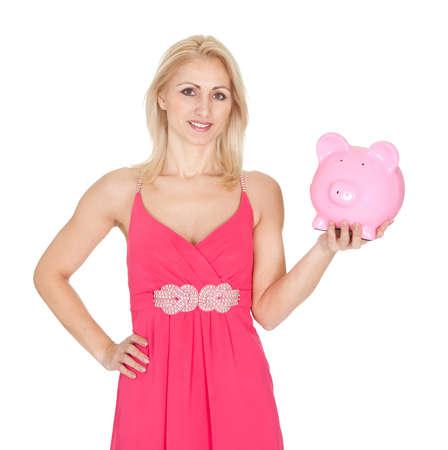 Beautiful woman holding a piggybank. Isolated on white Stock Photo - 12122816