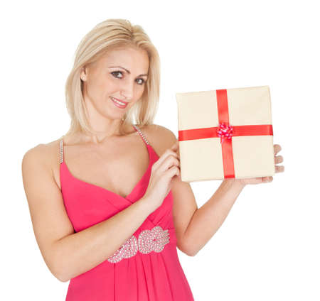 Beautiful young woman holding a gift box. Isolated on white photo