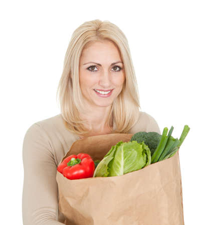 Beautilful woman with grocery bag. Isolated on white photo