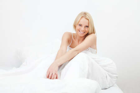 Young happy smiling woman waking up Stock Photo - 12475416