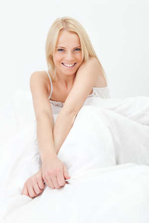 Young happy smiling woman waking up Stock Photo - 12475374