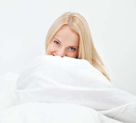 Young happy smiling woman waking up Stock Photo - 12475386