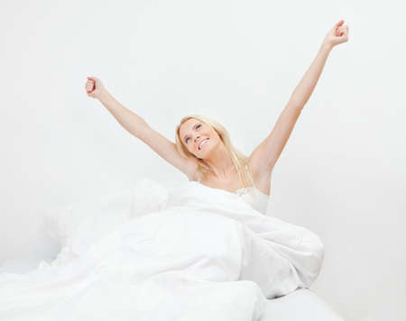 Young happy smiling woman waking up photo