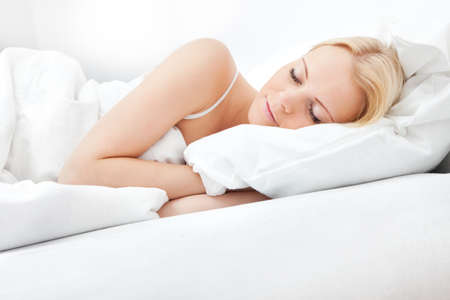 lying in bed: Young beautiful woman sleeping