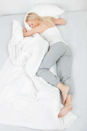 top angle: Young beautiful woman sleeping