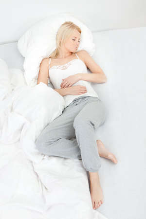top angle view: Young beautiful woman sleeping