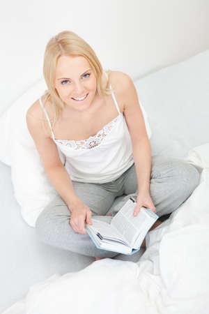 Young beautiful woman reading book Stock Photo