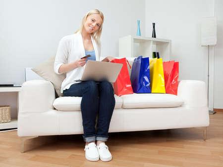 Beautiful woman shopping online photo