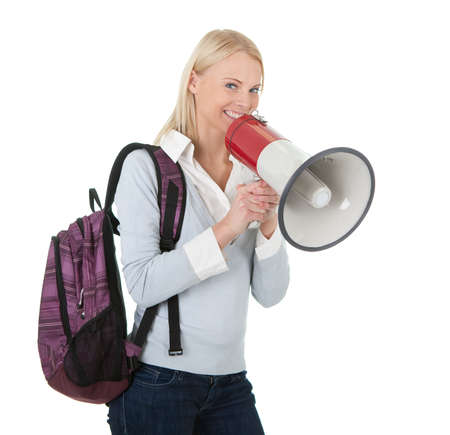 Beautiful student girl shouting in megaphone Stock Photo - 12475294