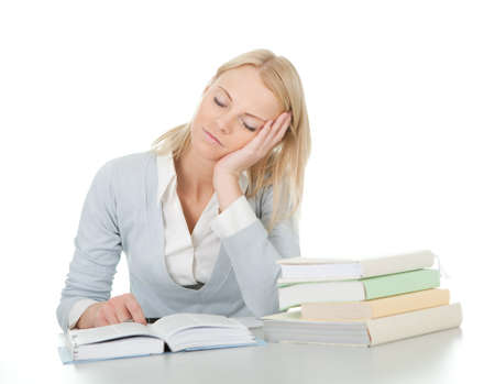 Beautiful student girl tired from doing homework Stock Photo - 12475303
