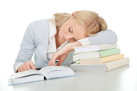 Beautiful student girl tired from doing homework photo