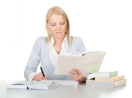 Beautiful student girl doing homework Stock Photo - 12475304